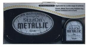 StazOn METALLIC - Тампон + мастило за всякаква твърда или гланцирана повърхност - плътно Сребро